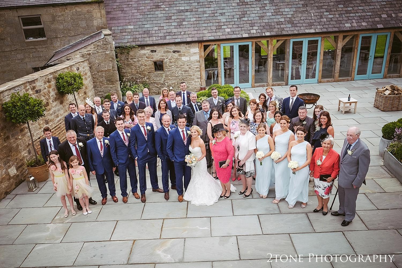 Group shot at Healey Barn by wedding photography team, 2tone Photography www.2tonephotography.co.uk