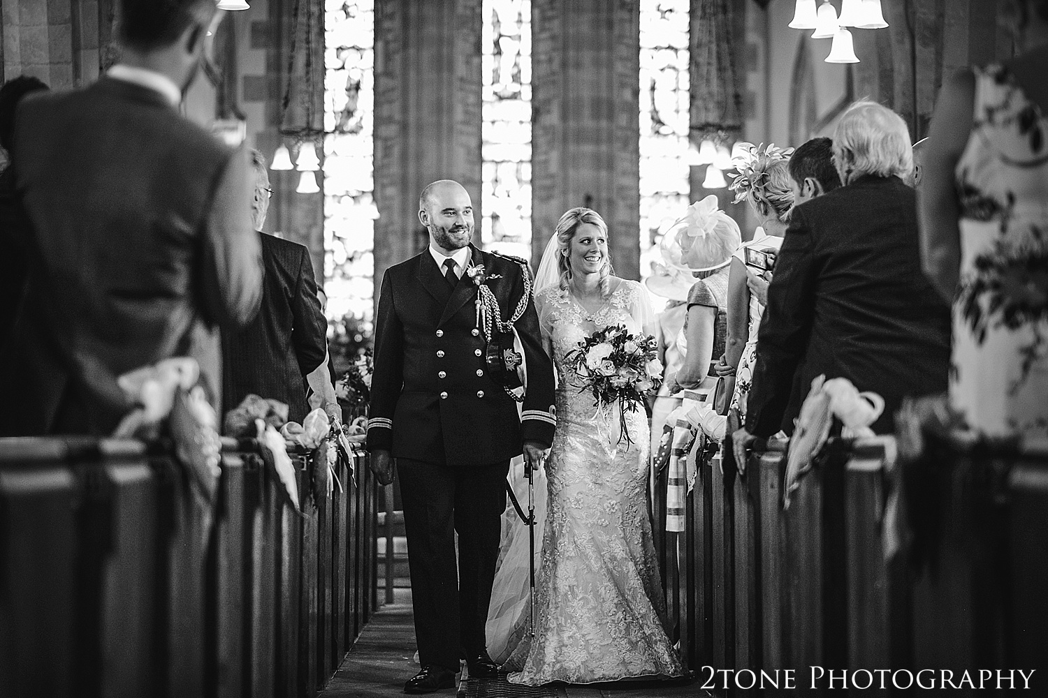 Wedding ceremony in Stamfordham in Northumberland.  Wedding photography at Matfen Hall by wedding photographer www.2tonephotography.co.uk