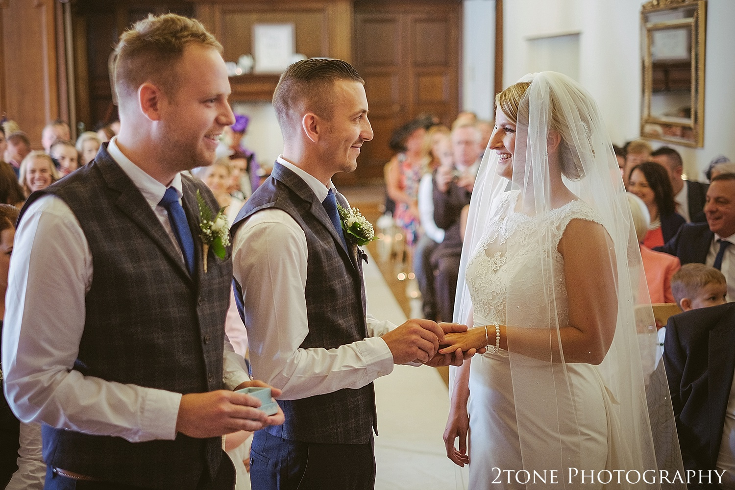 The exchange of the rings.  Wedding photography at Guyzance Hall by wedding photographers www.2tonephotography.co.uk