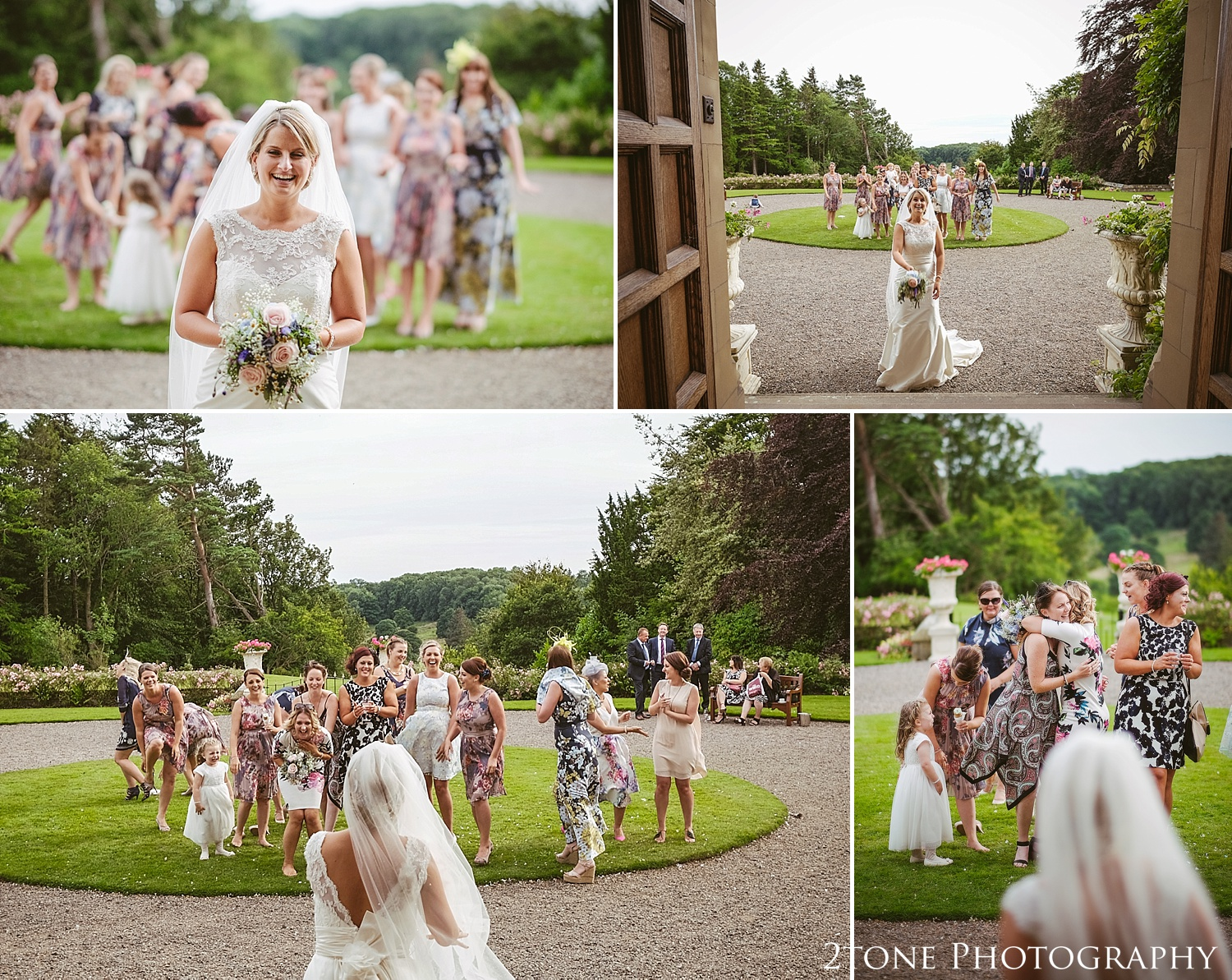 Bride throws the bouquet.  Wedding photography at Guyzance Hall by wedding photographers www.2tonephotography.co.uk