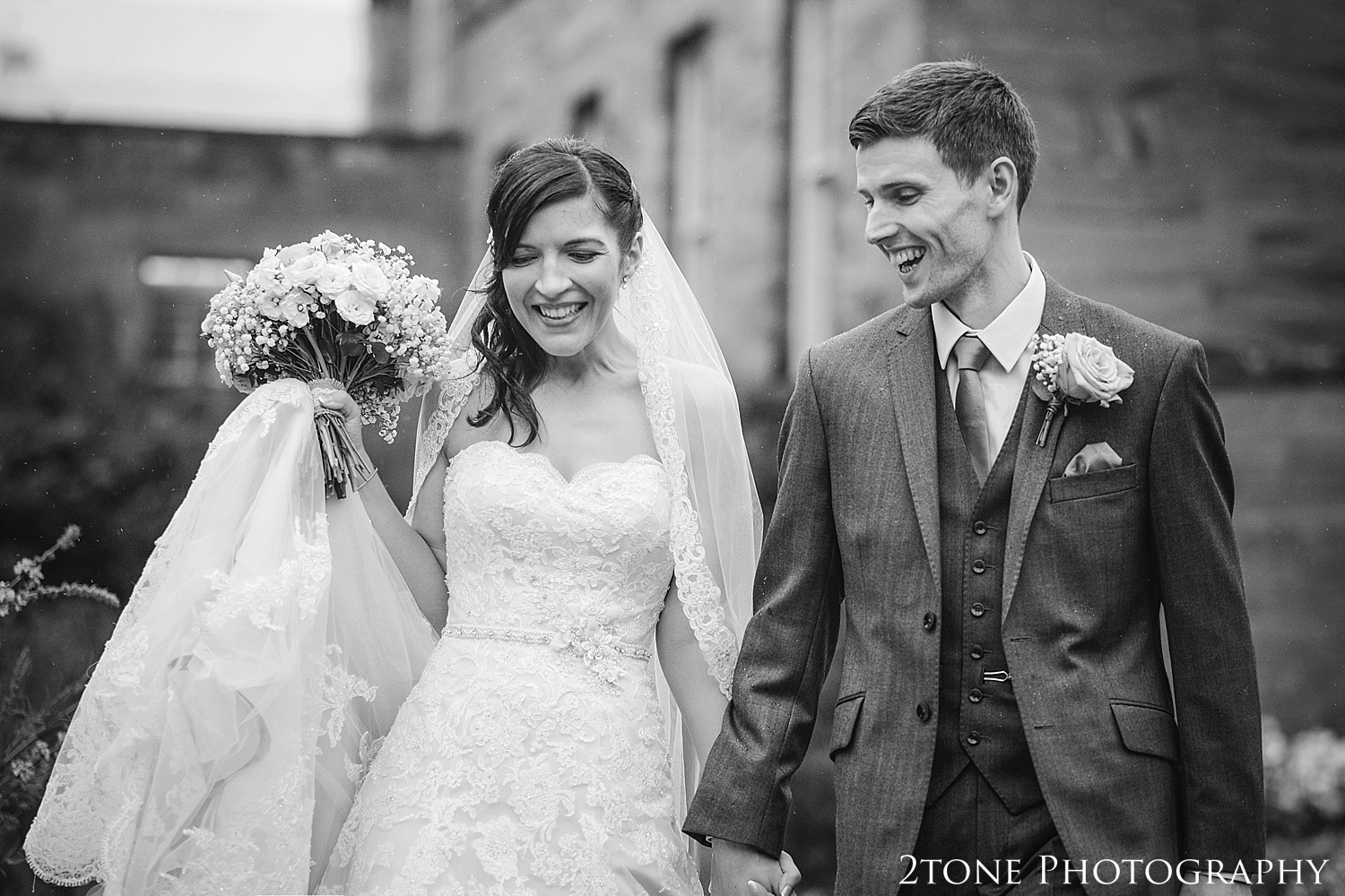 Weddings in the rain at Newton Hall by husband and wife wedding photographer team 2tone Photography.  www.2tonephotography.co.uk