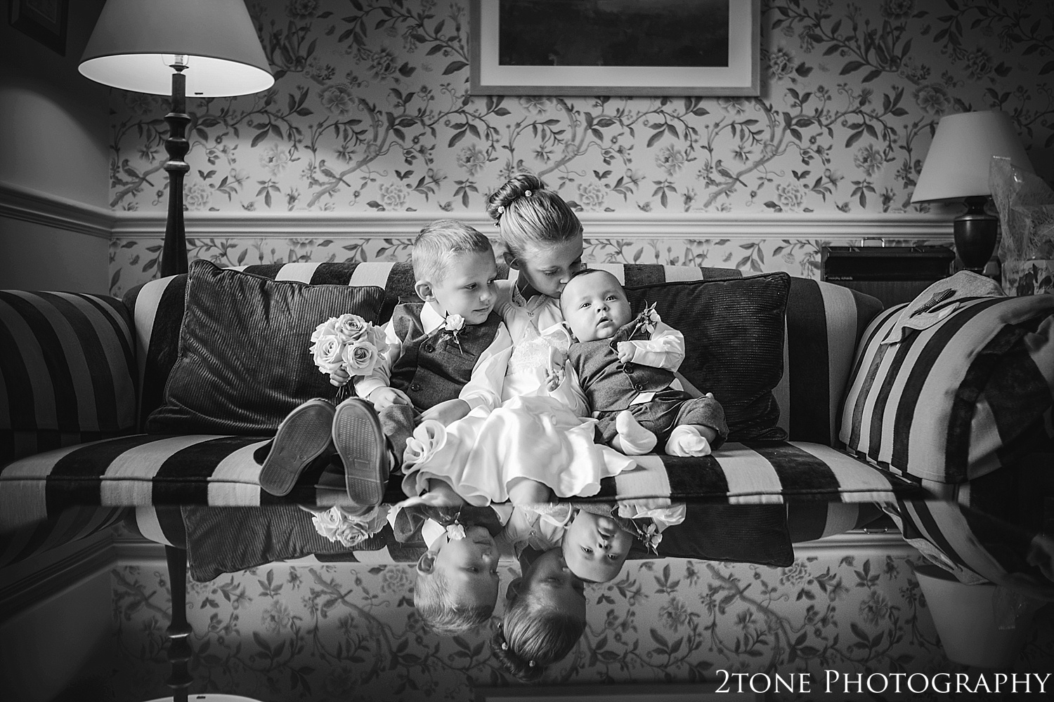 Flower girl and Paige boys.  Matfen Hall by Durham based wedding photographers 2tone Photography