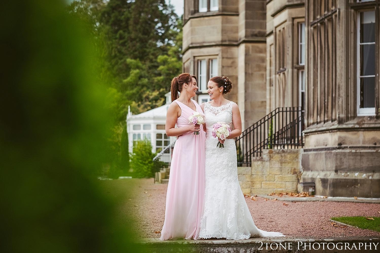 The bride and bridesmaid.  Matfen Hall by Durham based wedding photographers 2tone Photography www.2tonephotography.co.uk