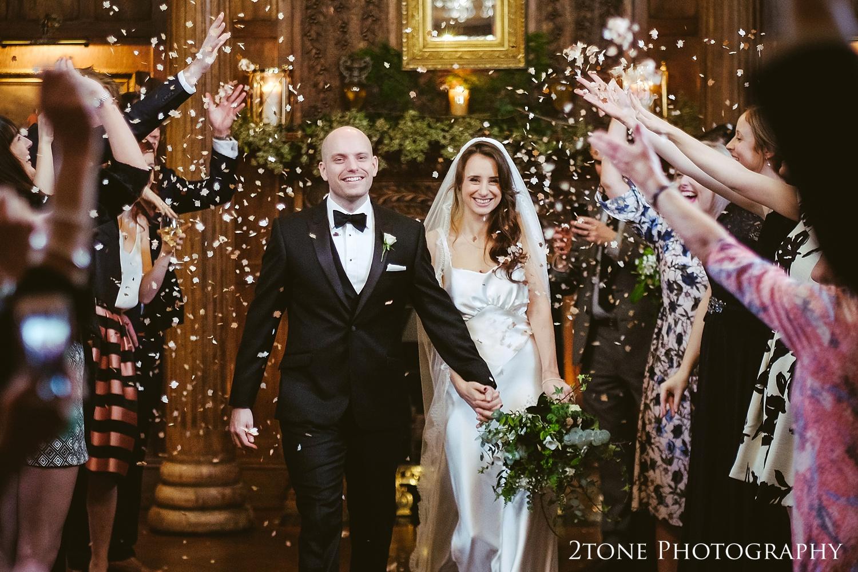 Wedding confetti at Ellingham Hall. Winter wedding photography by www.2tonephotography.co.uk