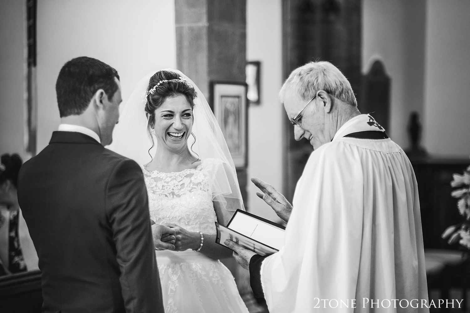 Wedding vows in East Coker, Somerset by www.2tonephotography.co.uk