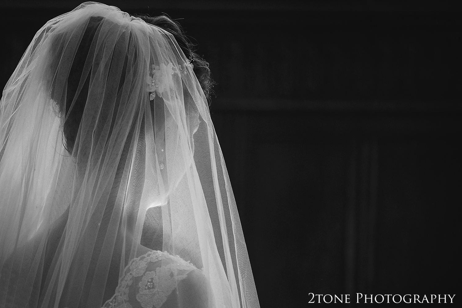 The bride in a church in Somerset by www.2tonephotography.co.uk