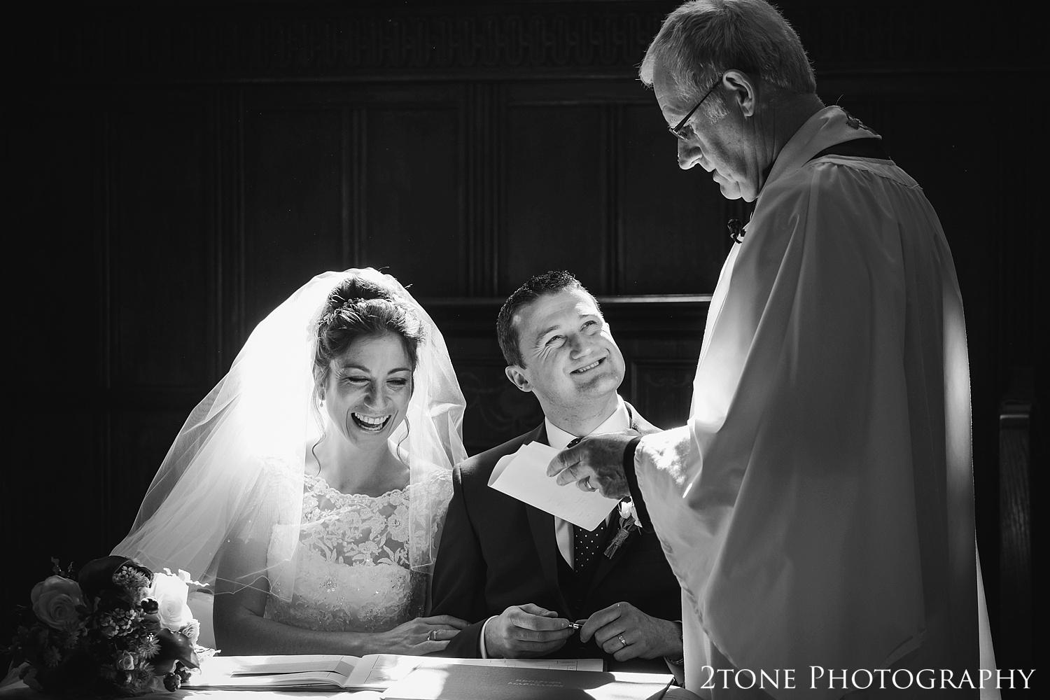Signing the register in church in Somerset by www.2tonephotography.co.uk