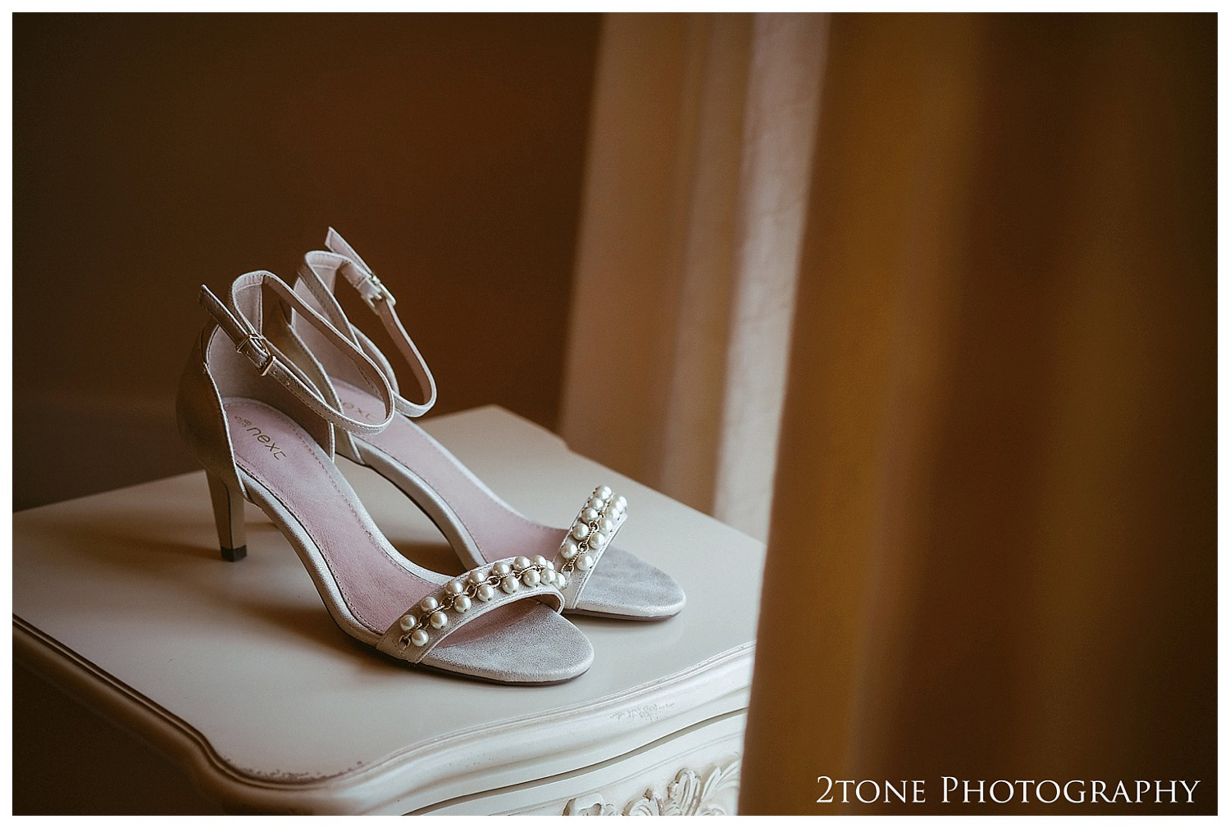 Bridal preparations.  Eshott Hall wedding photographs by wedding photographers based in Durham and the North East.  www.2tonephotography.co.uk.