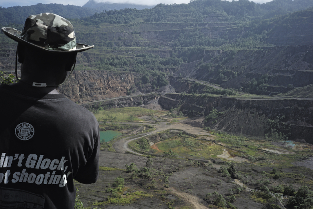 An ex-combatant looking out over Panguna mine, Panguna, Bougainville