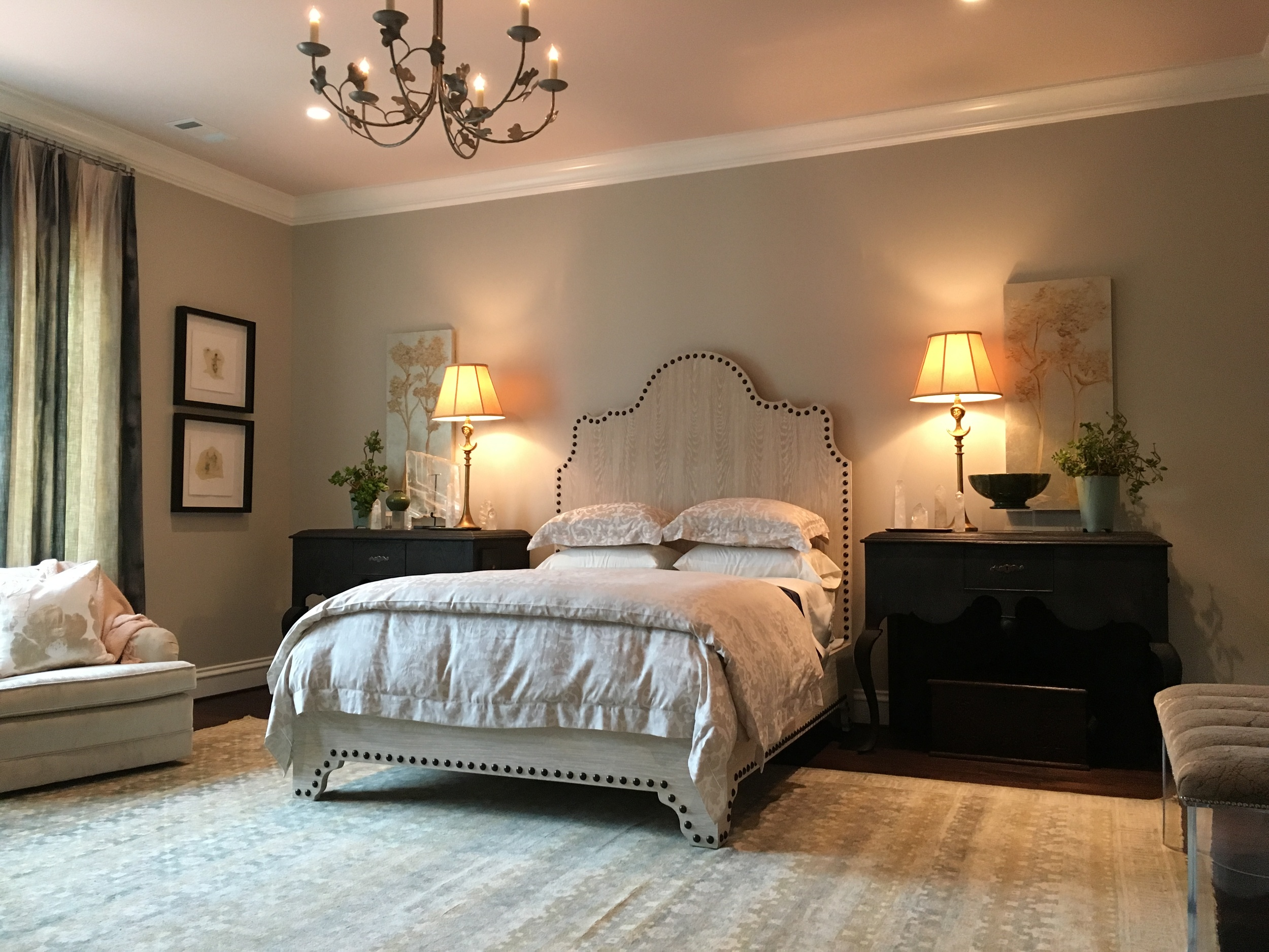 In the Home for the Holidays showhouse, I selected a pale, blush pink for the ceiling color.  The adjoining bathroom is also pale pink. There are soft blues in the rug, the artwork on either side of the bed and in the window treatments.  I also used crystal quartz obelisks on each bedside table.