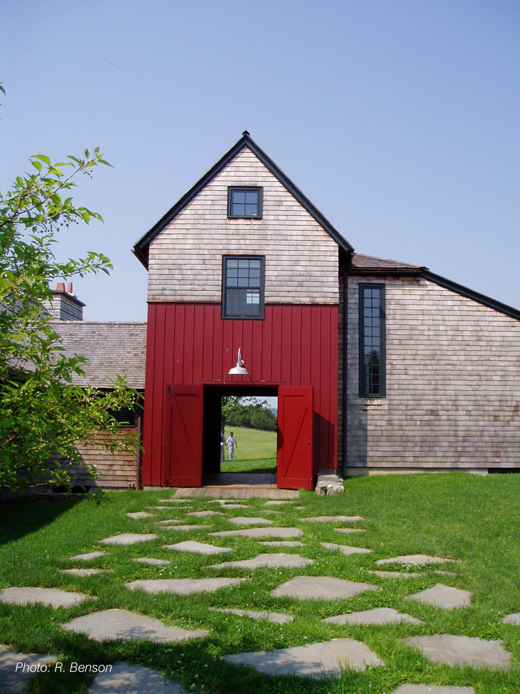 The architecture of this home, a contemporary interpretation of a classic farm complex, reflects the history of the site while looking to the future. The landscape responds to this by using local stone, a simple plant palette, and the remnants of old structures in the landscape composition. The future is celebrated by technology; photovoltaic cells powering the house and barn are placed in a field to appear as sculptural elements in the larger landscape.  The project received a 2008 BSA Honor Award for Design.