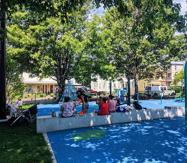 Whether it's a playground, bus stop, or outdoor seating at a restaurant, here's nothing that beats the heat like shade trees! At Gramstorff Park, this seat wall is perfectly positioned to take advantage of the existing trees that were protected in the park redesign, as well as providing separation between the toddler play area and the belt swings. Where is your favorite shady summertime outdoor space?  #parksandrec #parkdesign #landscapearchitecture #shade #beattheheat #summer#dogdays