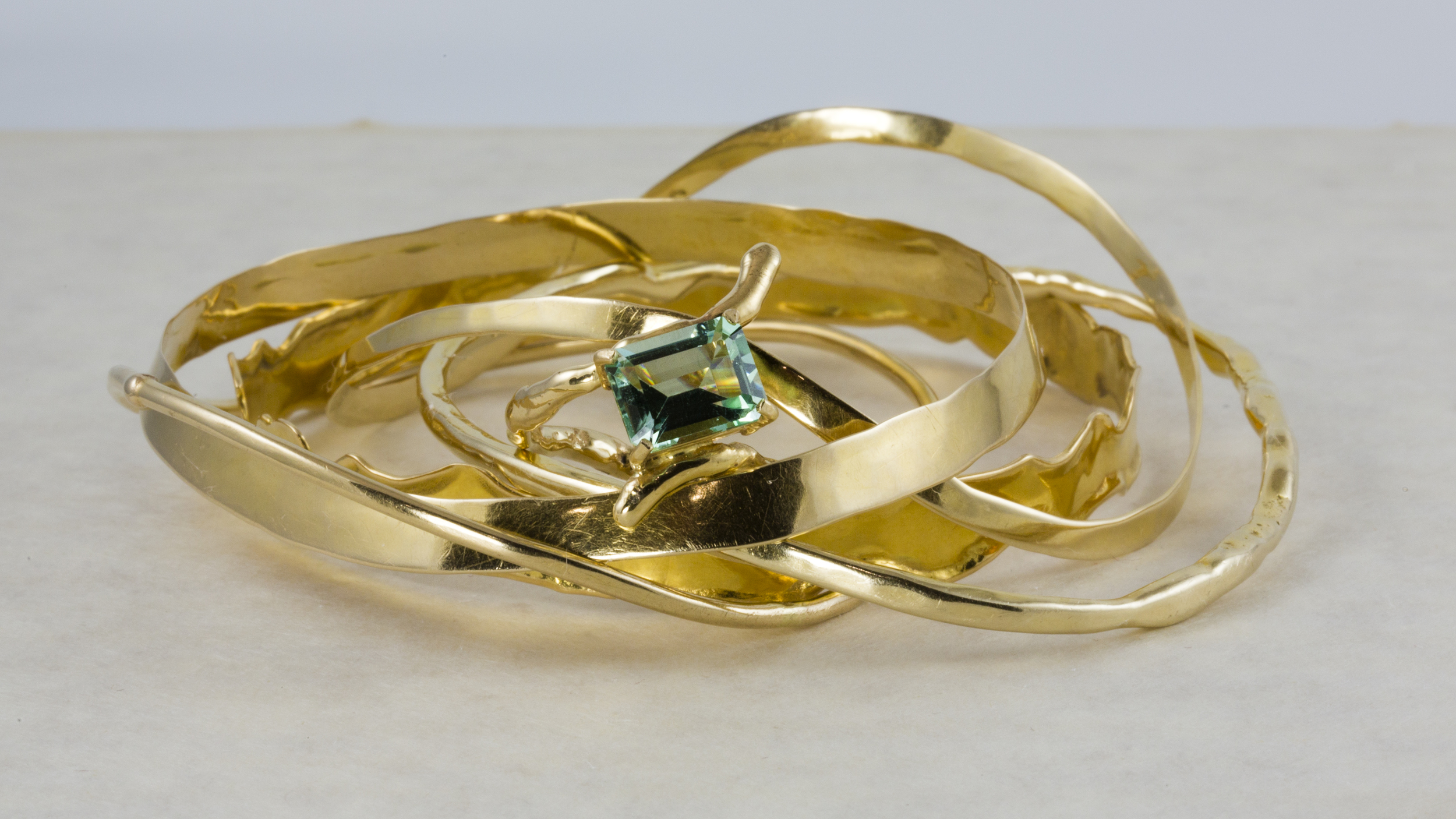 """Twig"" Bracelets, Surrounding the ""Twig"" Ring, set with a Green Blue Tourmaline"