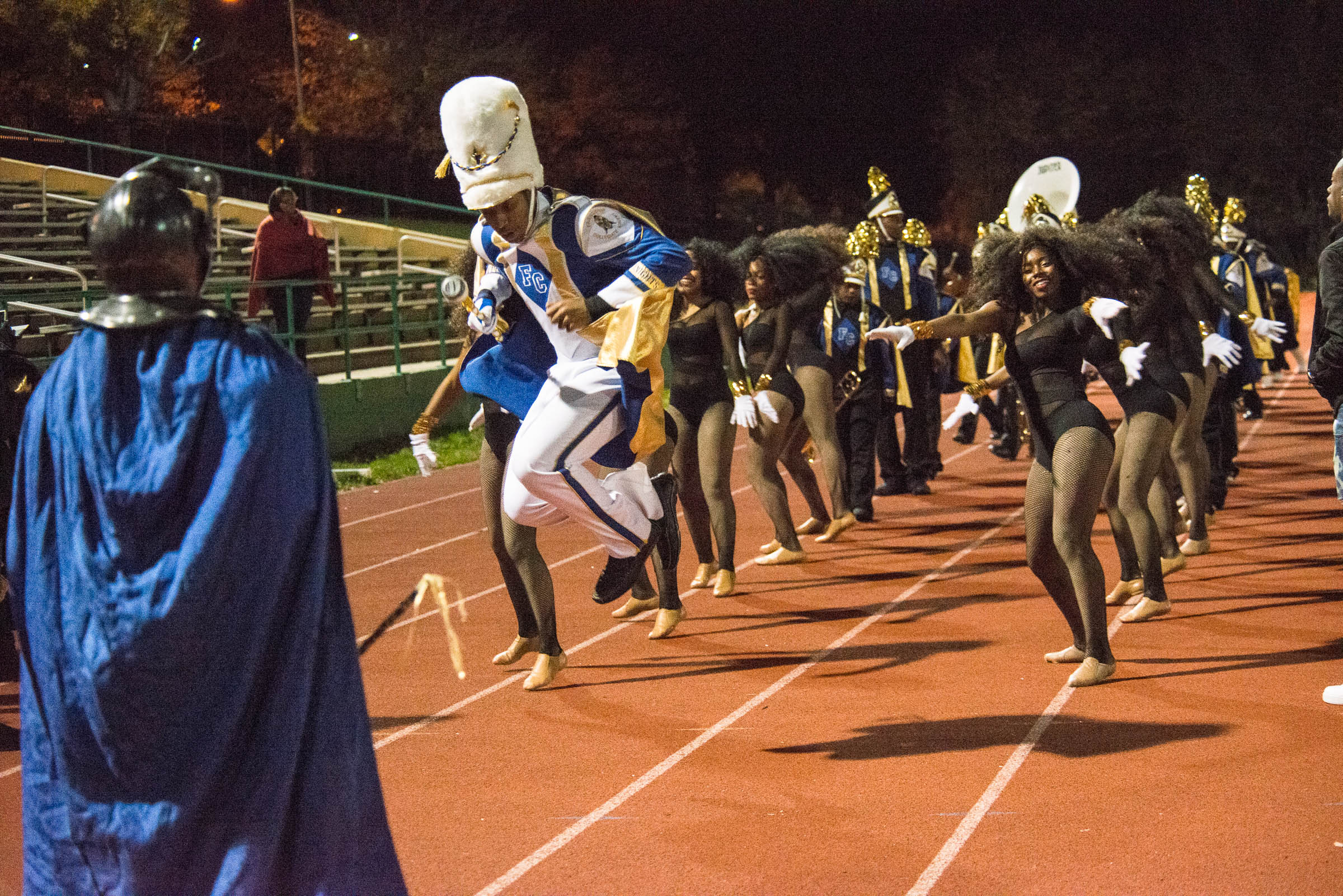 Drum Major, Trevell Brown, leads the band and dancers onto the field for the half-time performance.
