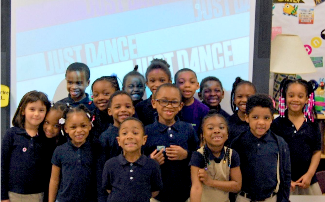 """Mrs. Graves and Ms. Chappelle's Kindergarten Class pose after having a """"Just Dance"""" movement break."""
