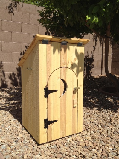 Completed gas tank outhouse with decorative hardware