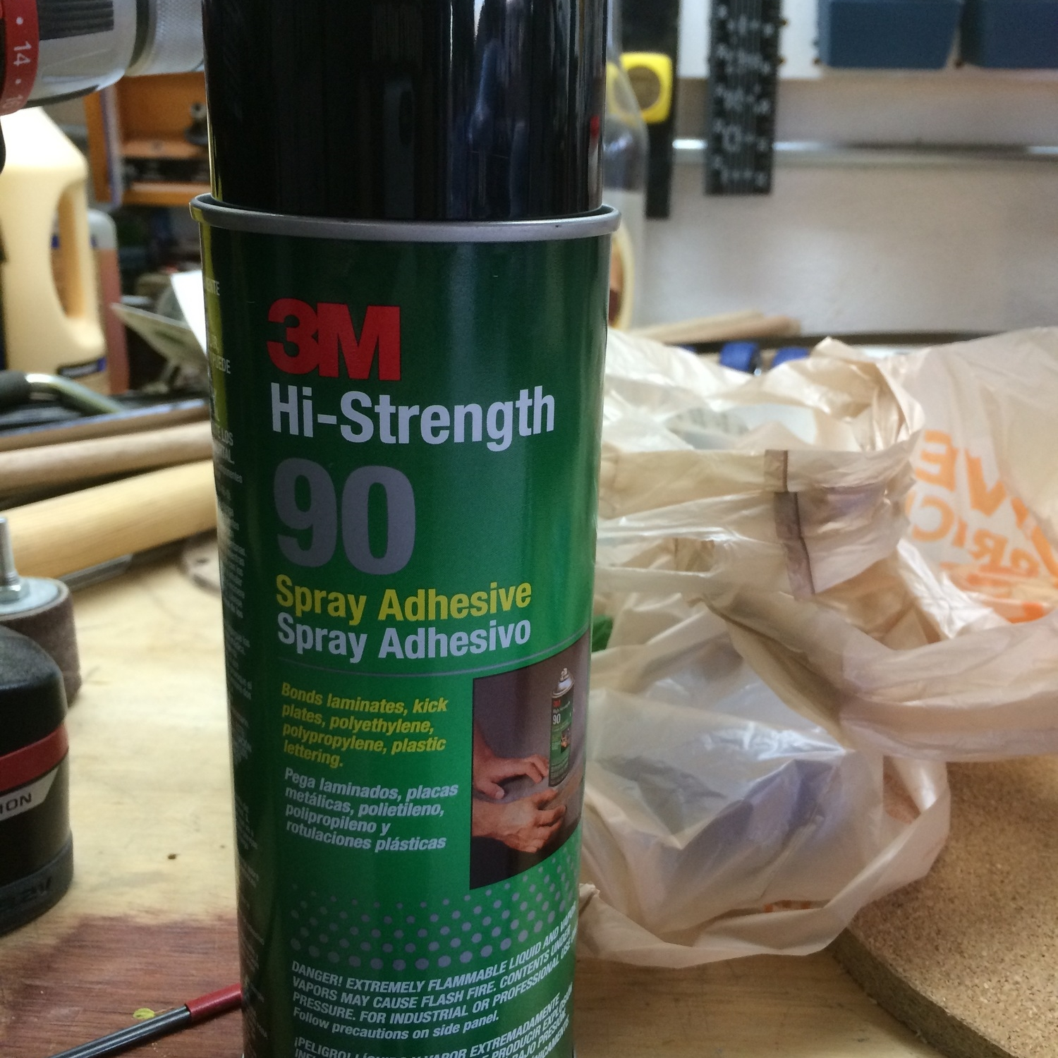 Favorite old standy-by spray adhesive from 3M to stick the felt to the cork board