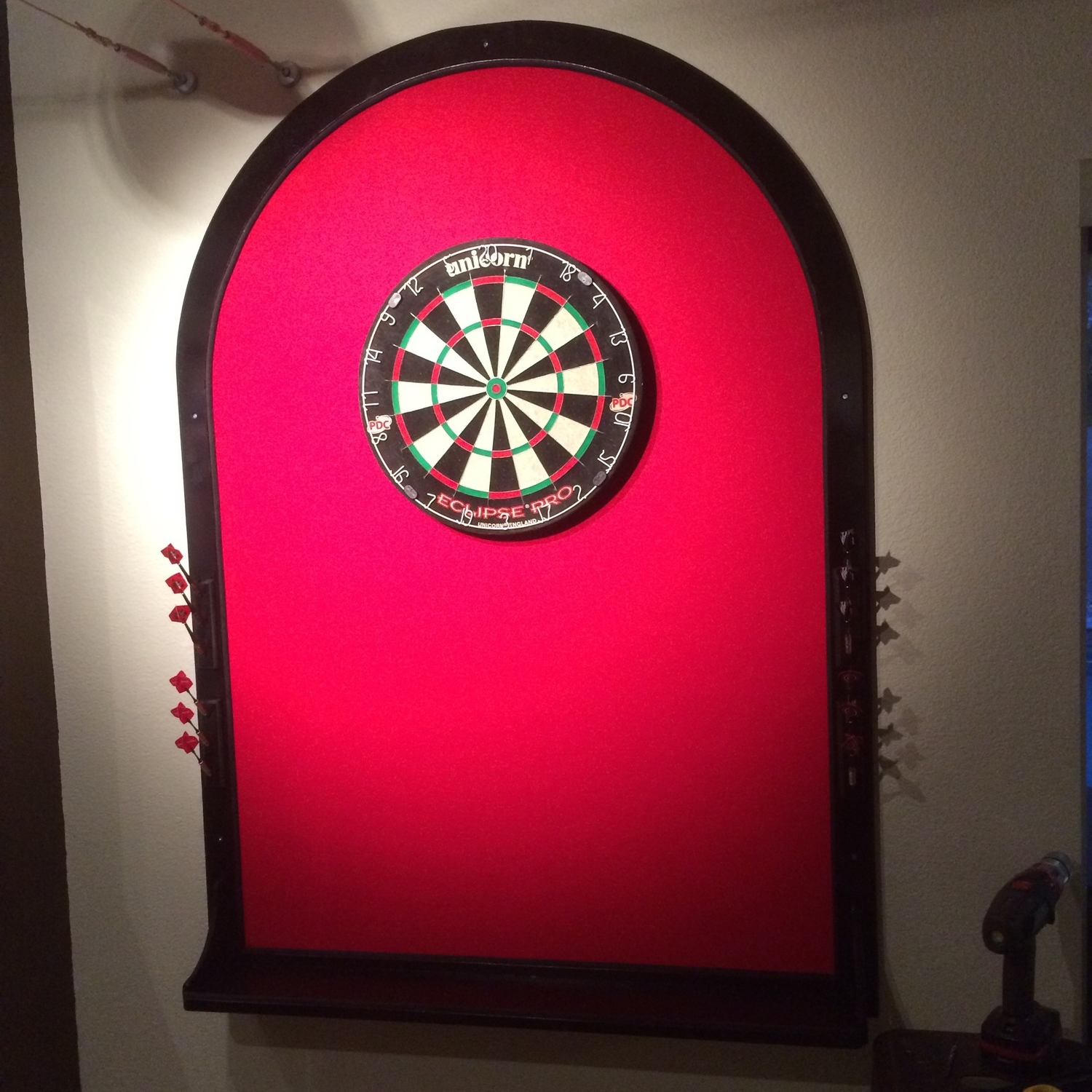 Finished dartboardbackstop with red felt and black paint