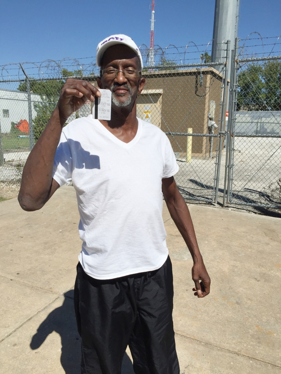 Randy with his month-long bus pass that will take him back & forth to treatment for his prostate cancer.