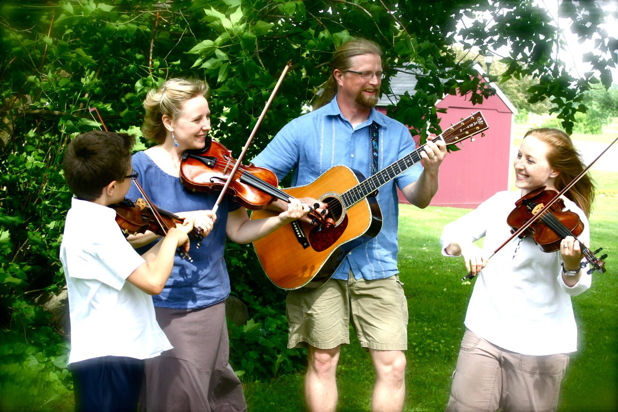 Gretchen & Rebecca Koehler surrounded by family, Sylvain Koehler Foisy (fiddle), and Brandt Kronholm (guitar.)