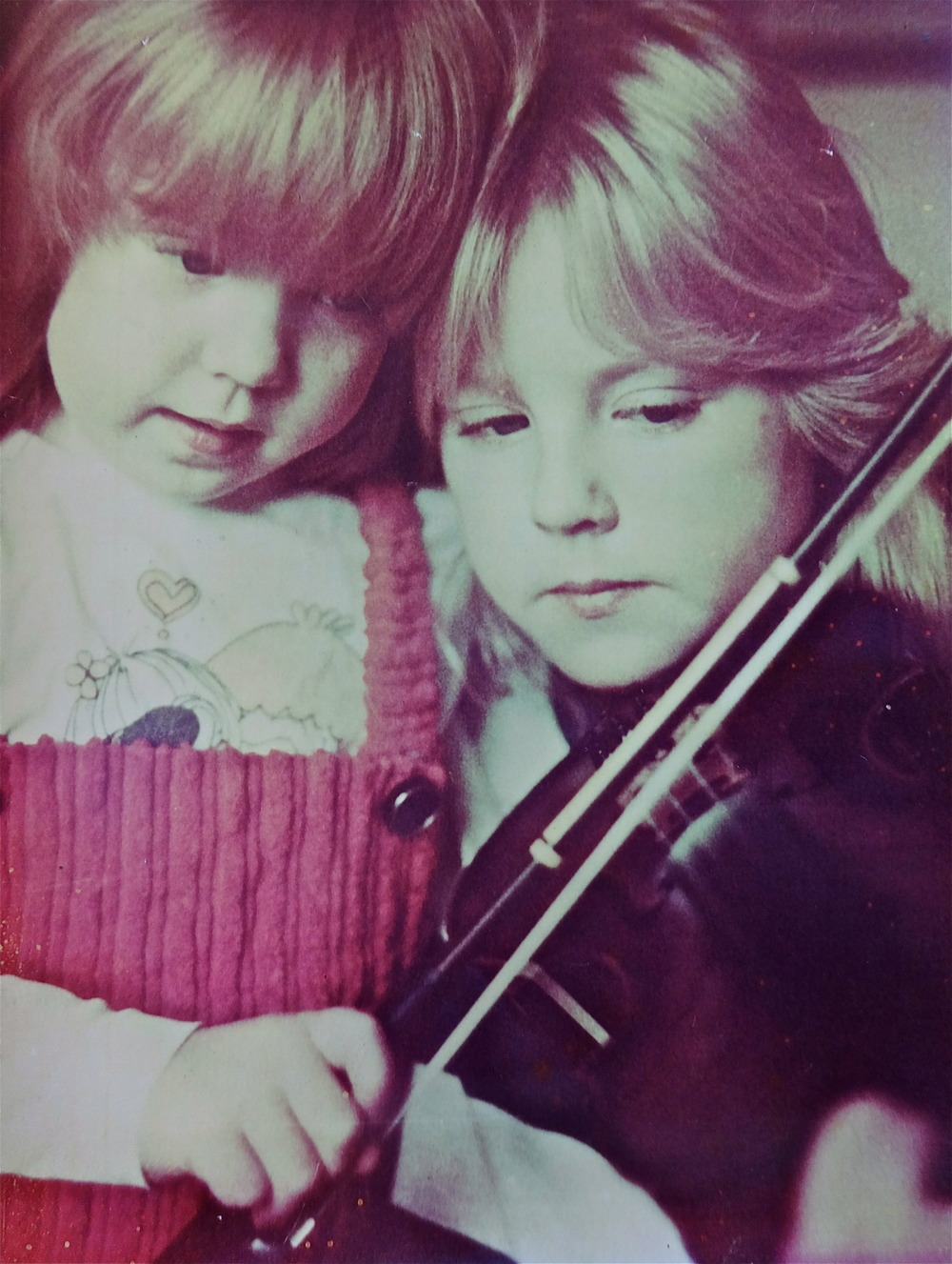 TWO HEADED FIDDLER - Not only is this an audience favorite, but it is a useful teaching tool that allows beginners to focus on one hand at a time. I tell my young ones to share a fiddle and a hug with their practice buddy at home.To fancy things up, players can using various