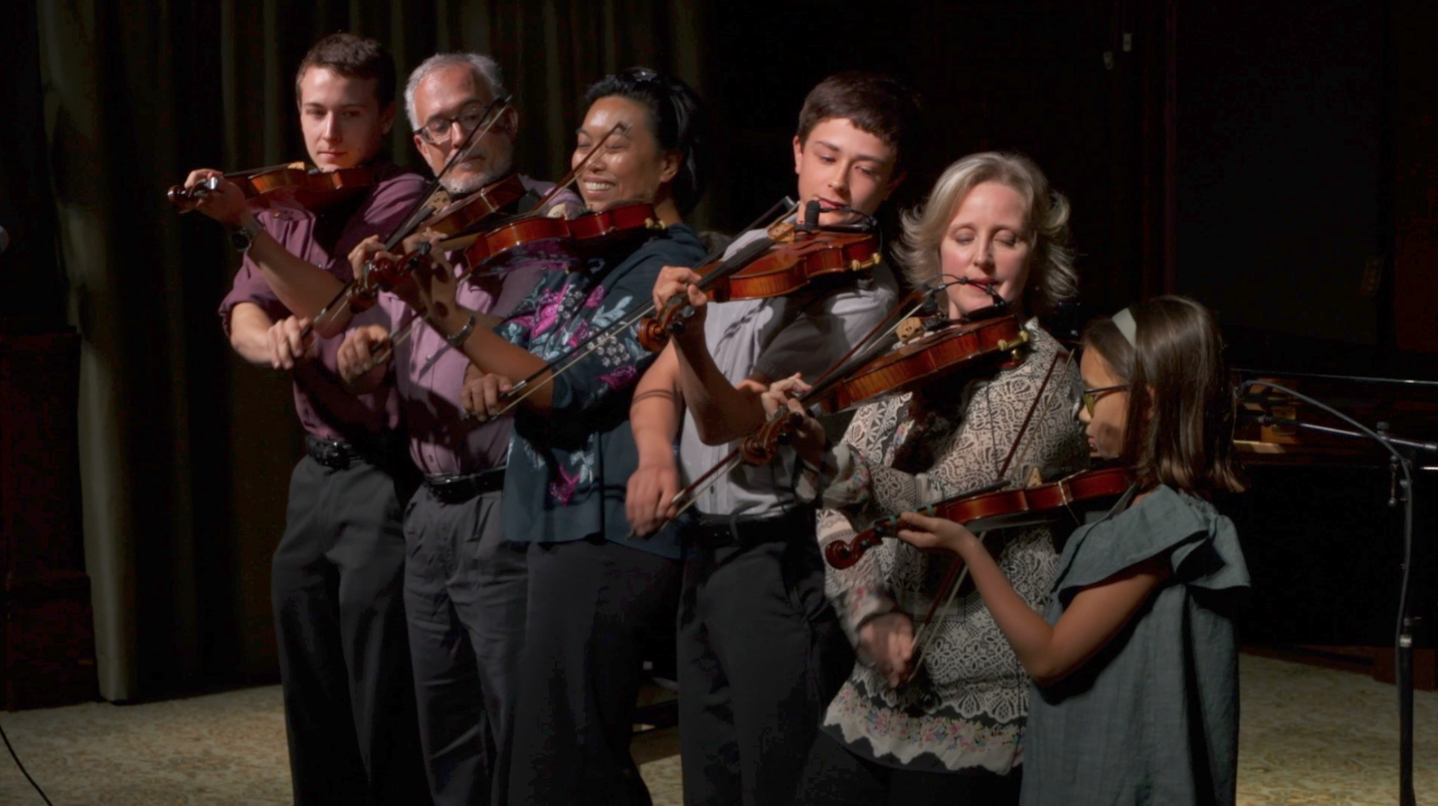 """Members of the Koehler-Foisy & Kelly families performing the trick called """"the 6 headed Fiddle Monster!"""""""
