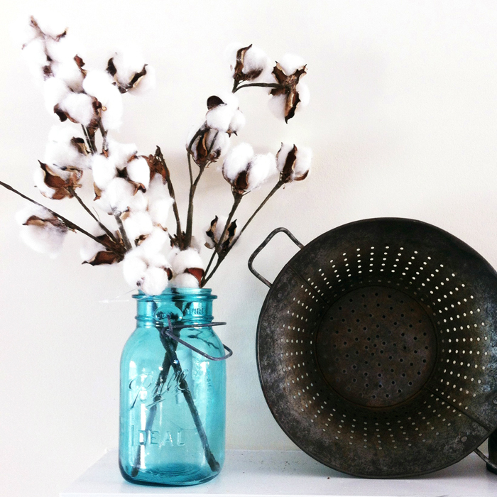 cotton in a blue mason jar