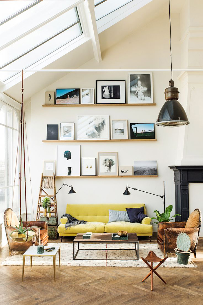 shelving and artwork with a high ceiling