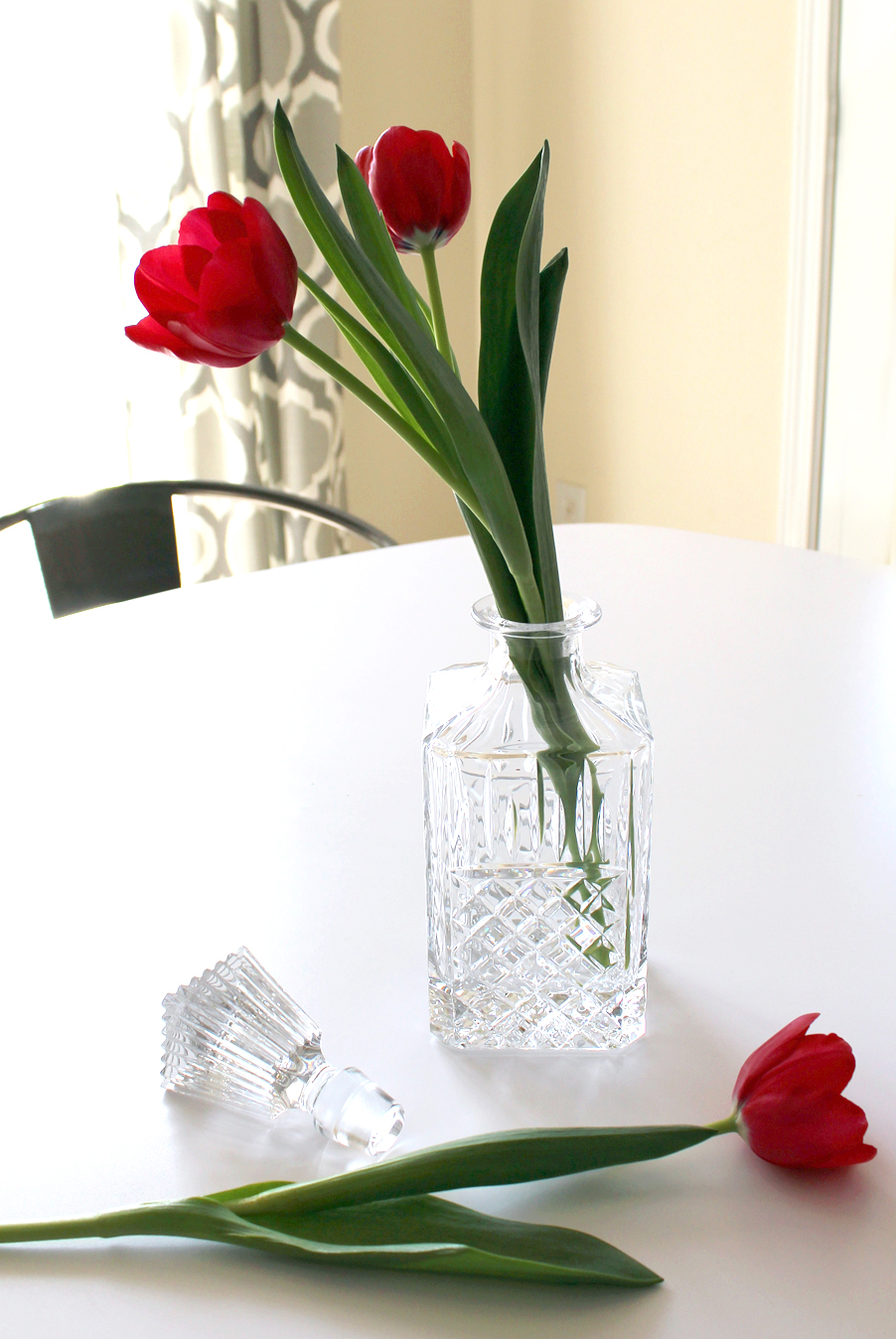 Add flowers to a sparkly crystal decanter