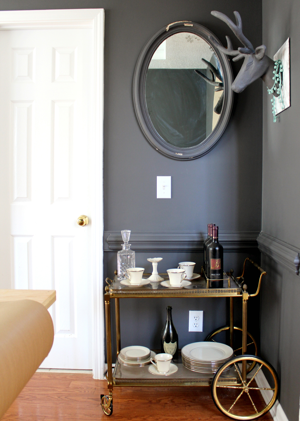 a budget-friendly dining room makeover. dark grey Sherwin Williams Peppercorn with vintage bar cart | tag&tibby