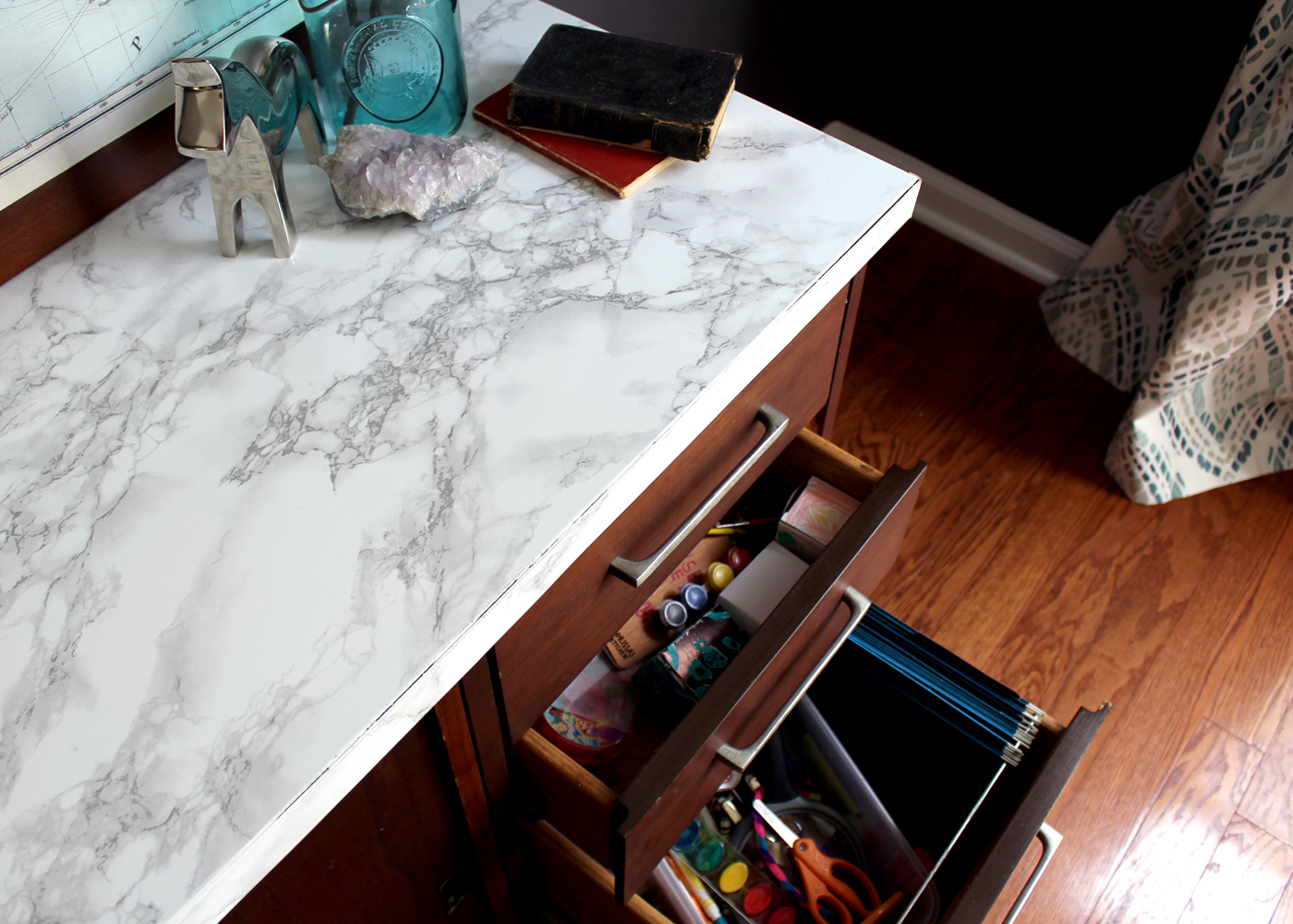 vintage thrift store dresser covered in marble contact paper