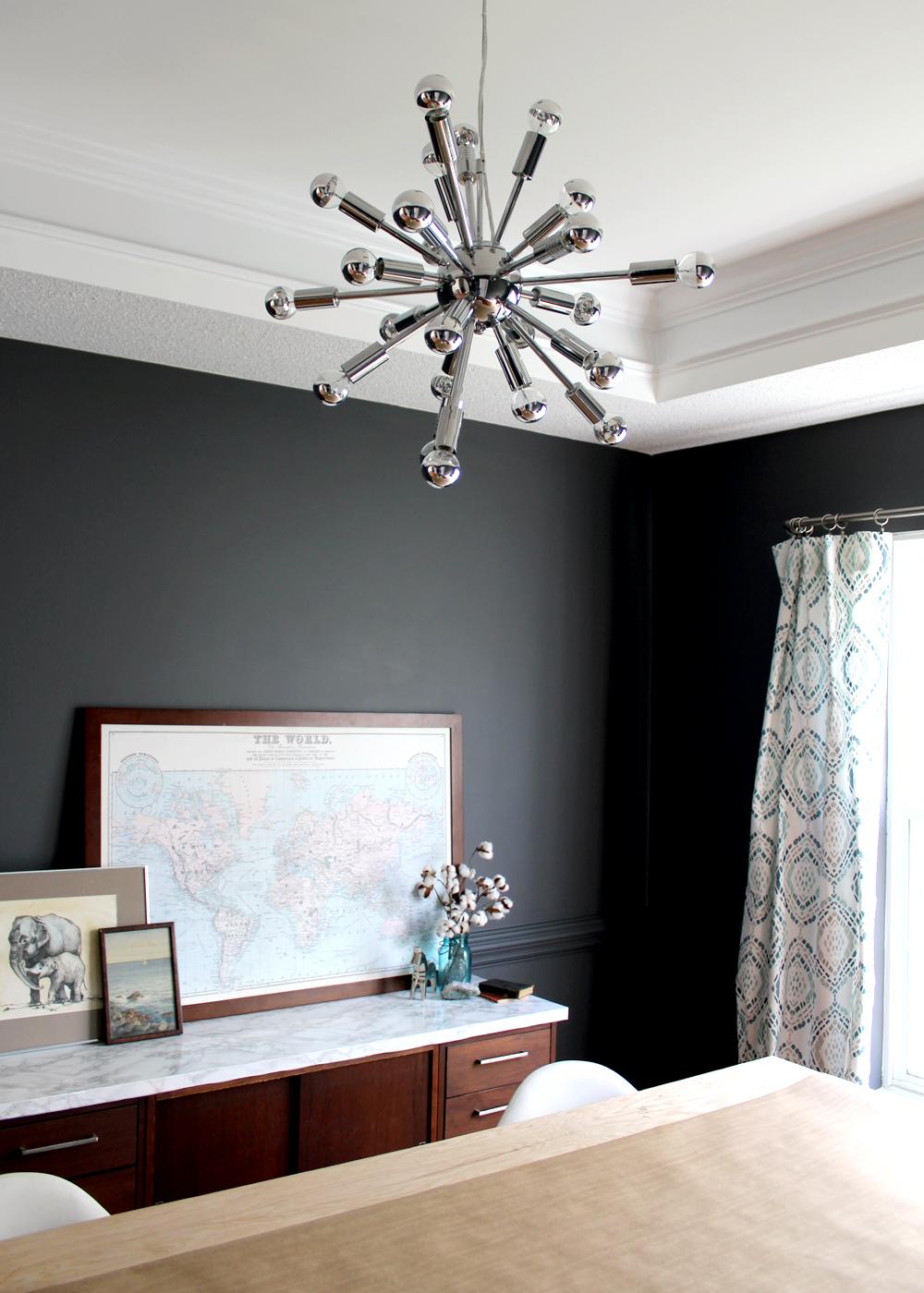 dark grey dining room with modern sputnik pendant light | tag&tibby