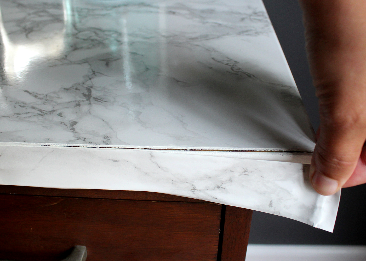 apply contact paper to front edge of furniture
