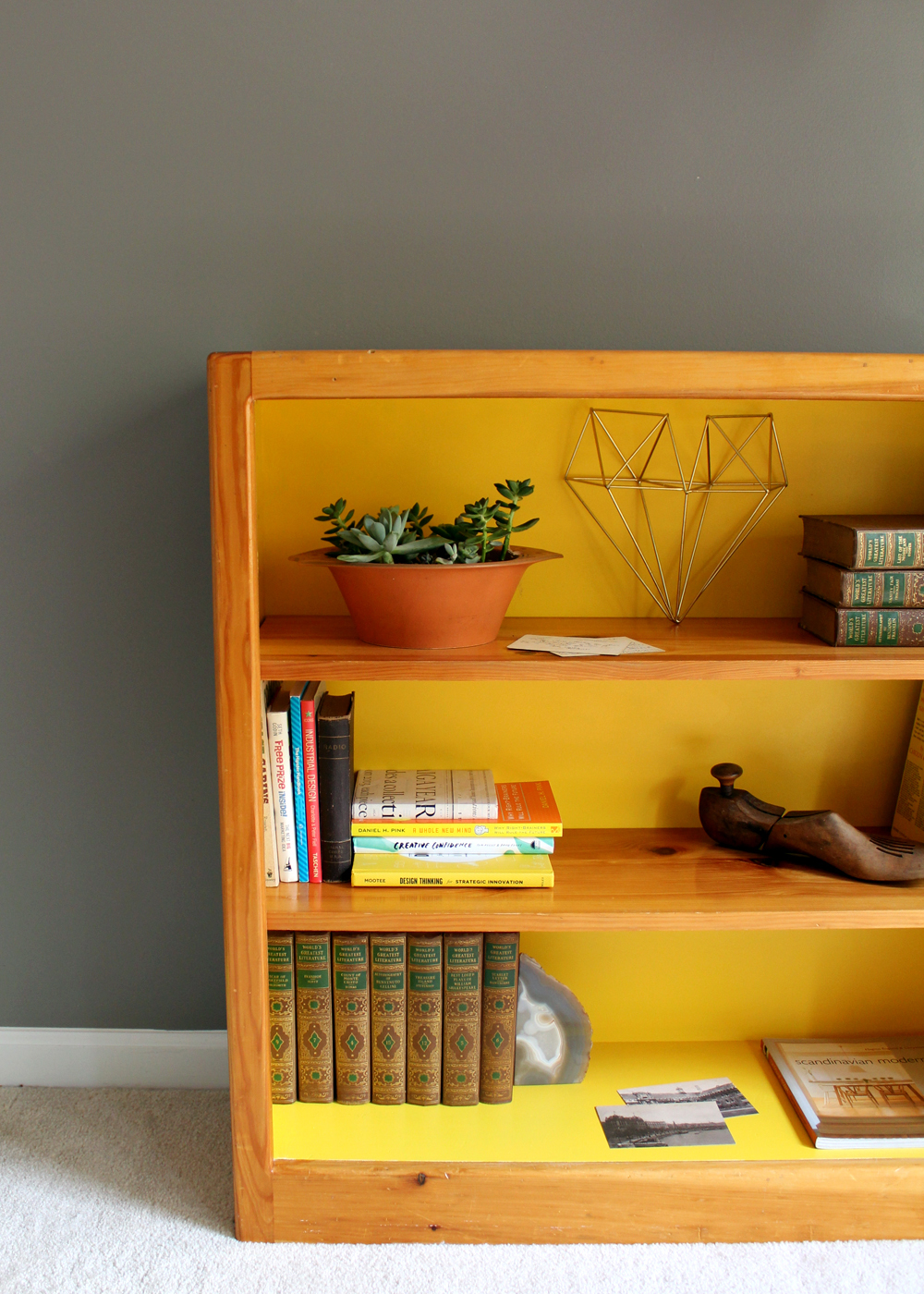 thrift store bookcase painted Sherwin Williams Cheerful. (walls painted SW Dovetail Gray)