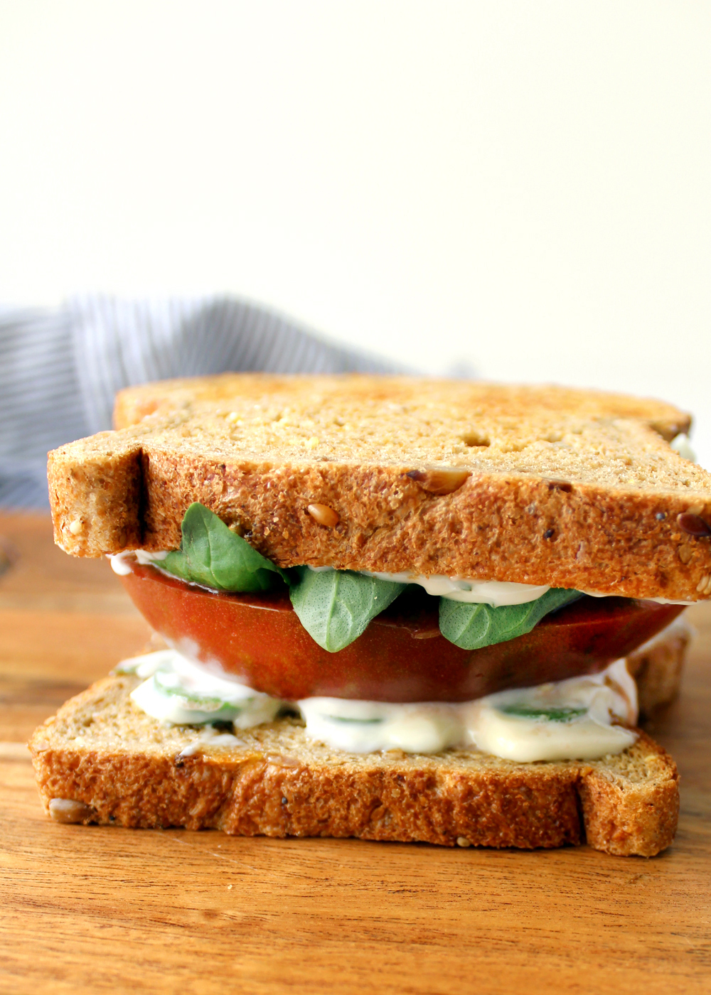 learn how to make this delicious, fresh tomato sandwich using an heirloom tomato and basil