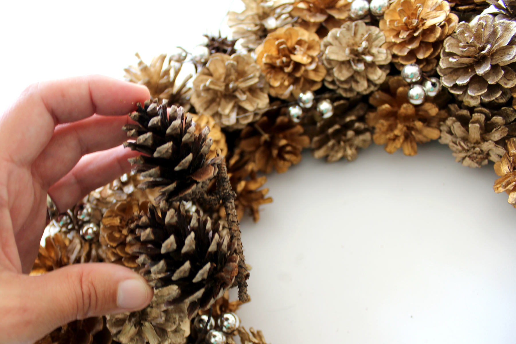 Add small pinecones with glue