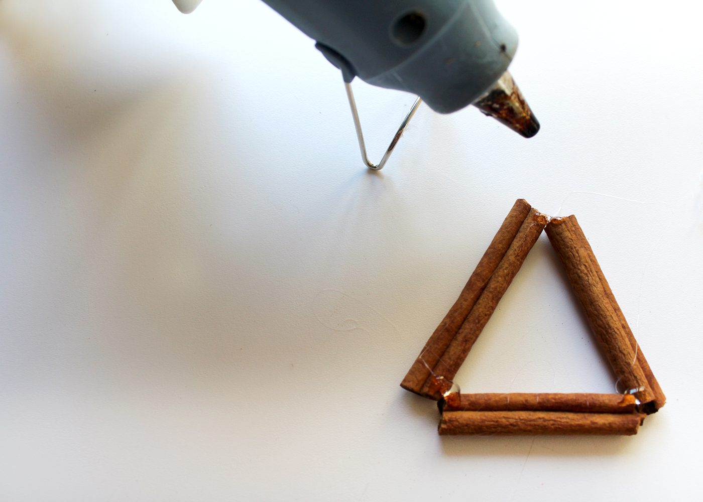 glue cinnamon sticks into triangle shape