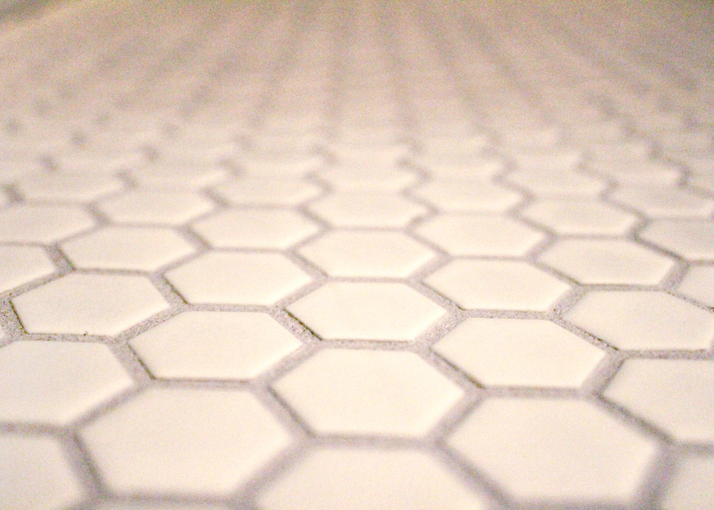white hexagon tile with grey grout
