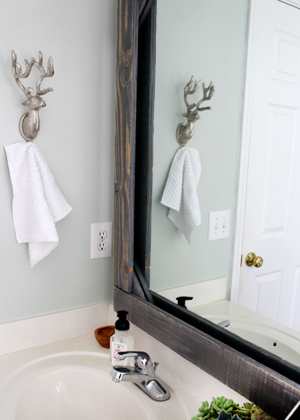 customize your bathroom mirror with a rustic wood frame!
