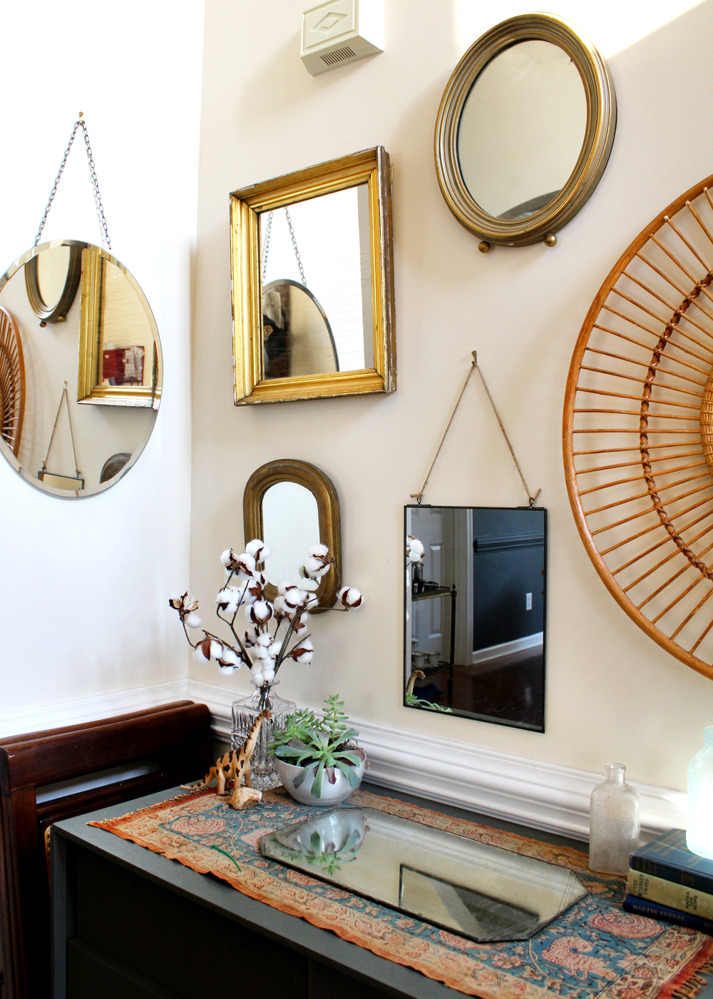 How to design a mirror gallery wall: be sure to add some low mirrors for children, and a few at eye level for adults