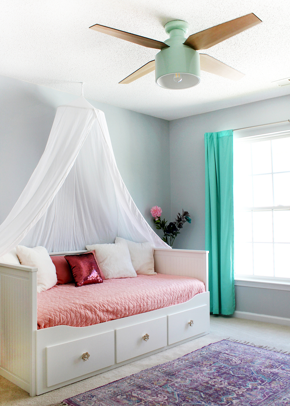 tween girl bedroom with mint ceiling fan and cheerful daybed with canopy