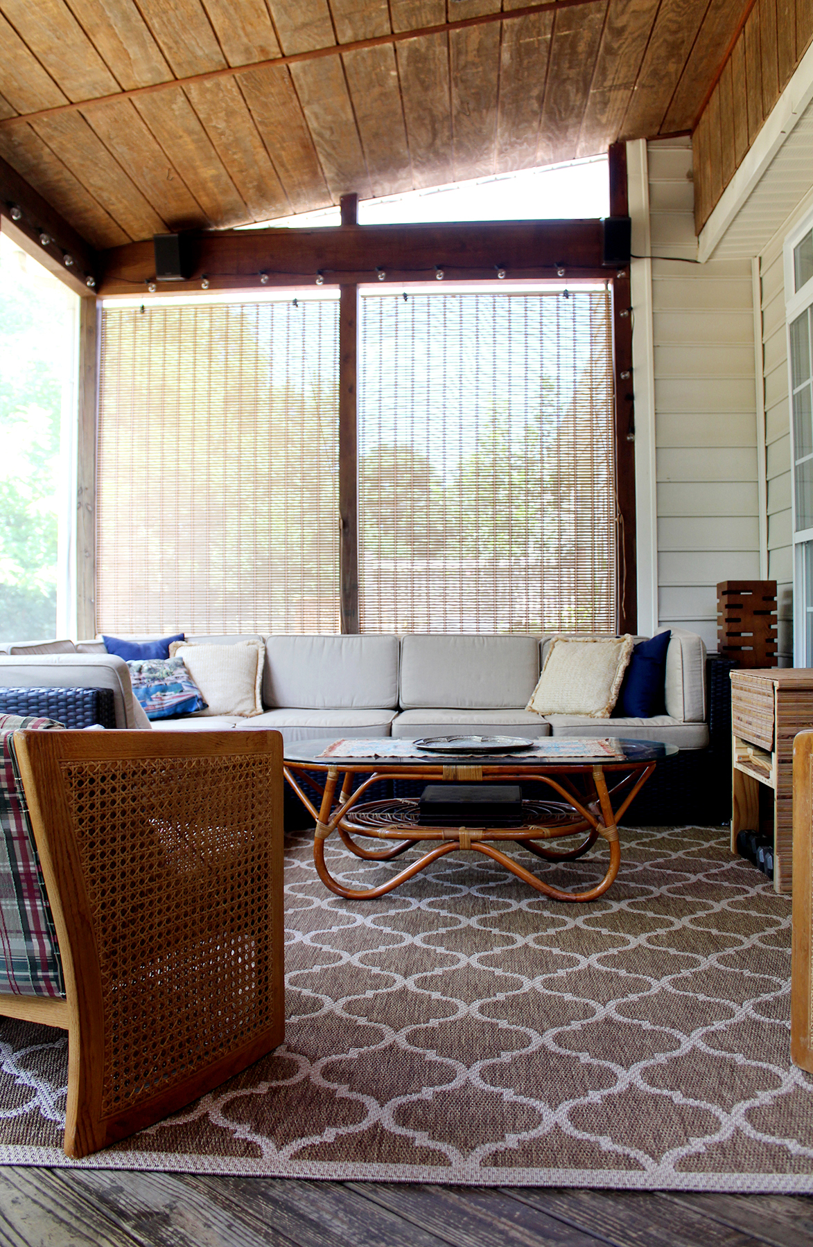 screened porch with sectional and vintage coffee table