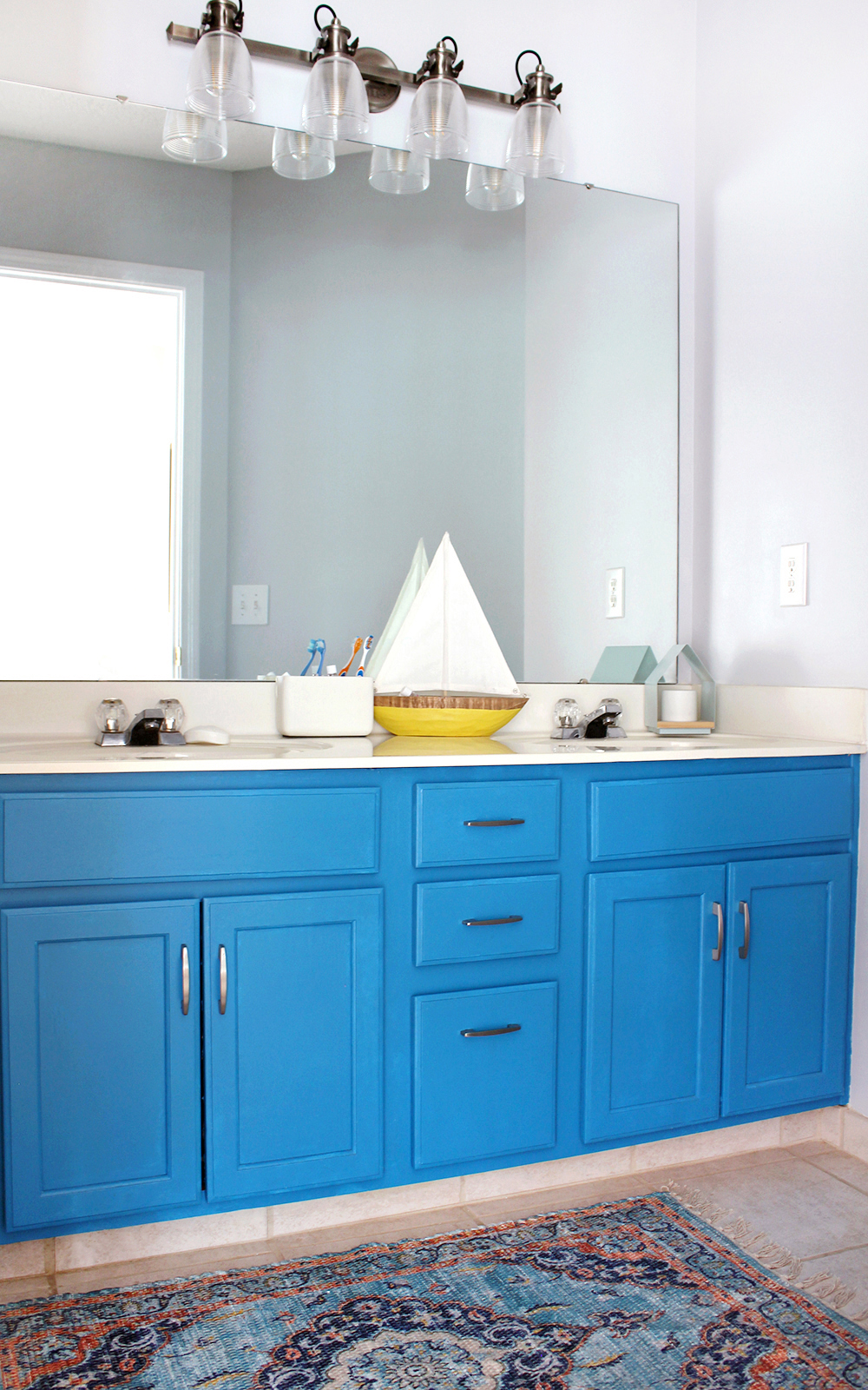 cheerful kid's bathroom with SW Misty blue walls