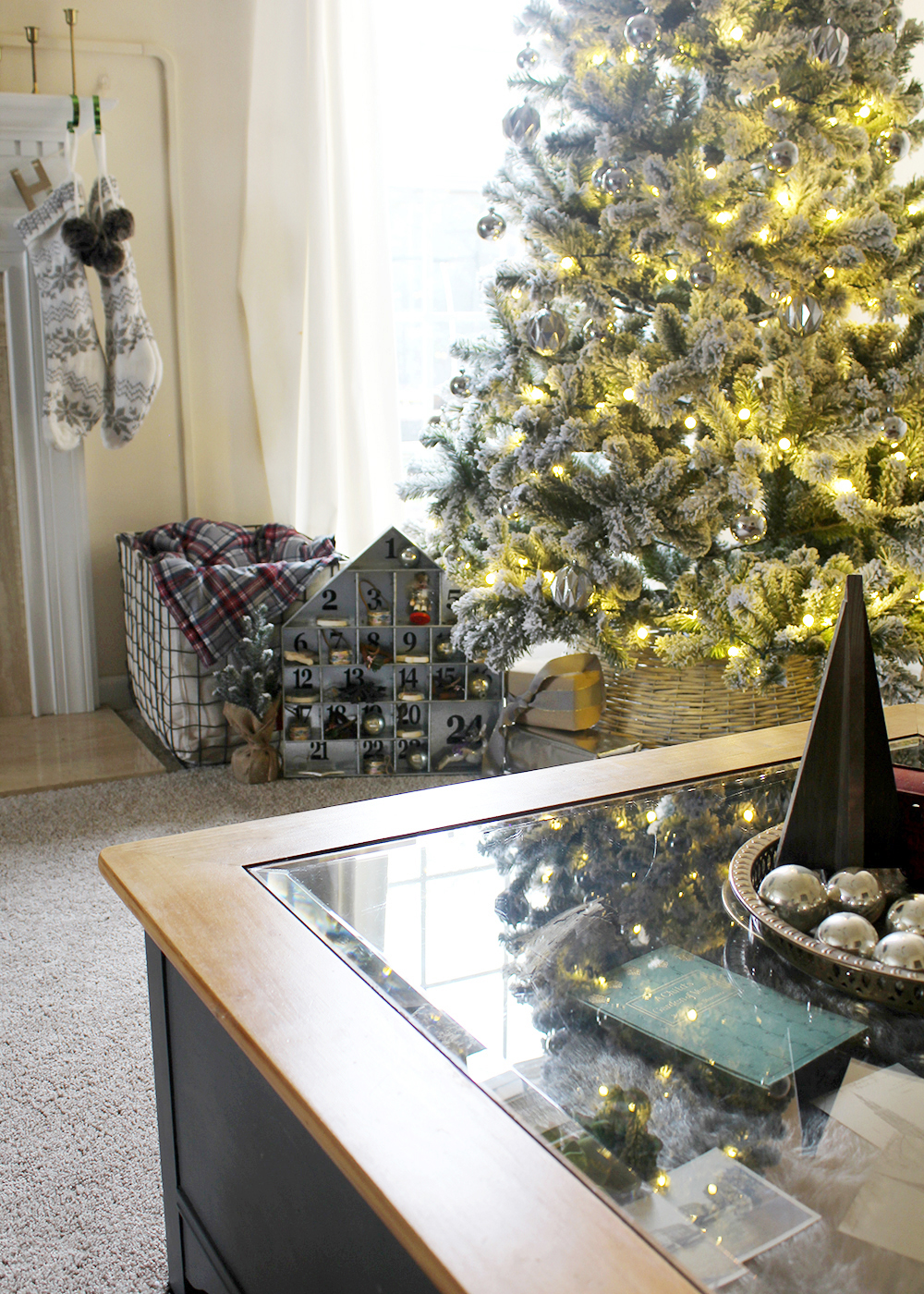vintage accents surround a modern, flocked Christmas tree #ChristmasDecor #FlockedTree