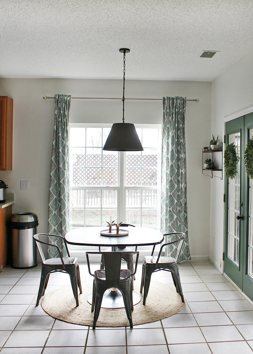 Global-Inspired breakfast nook on a small budget with green french door and jute rug