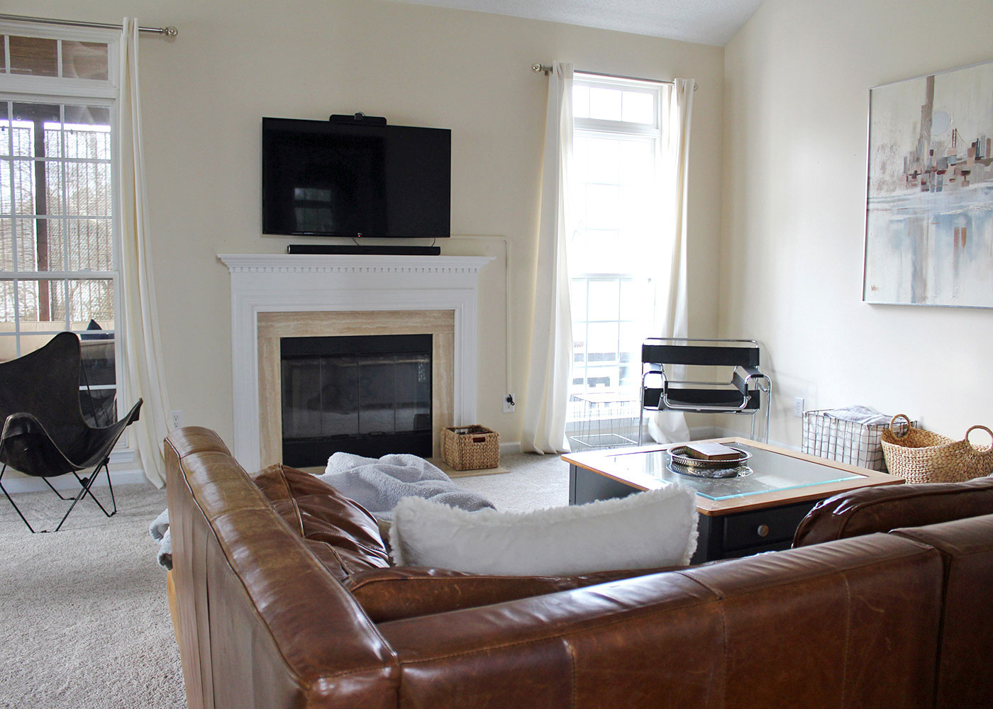 living room with fireplace and flat screen tv (before makeover)