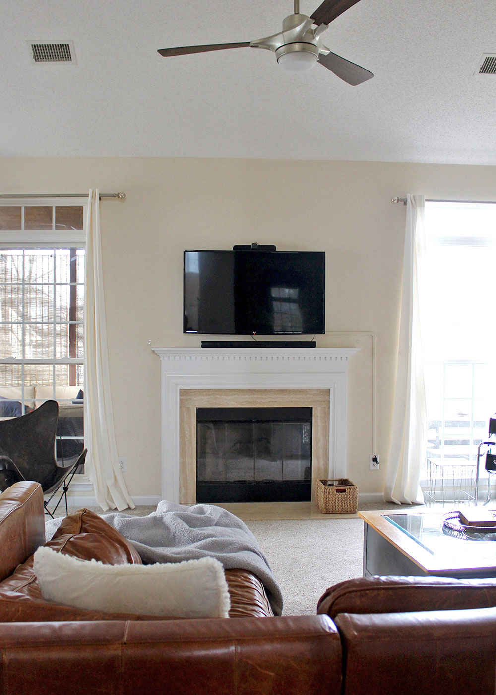 living room with sectional, fireplace, and flat screen tv (before makeover)