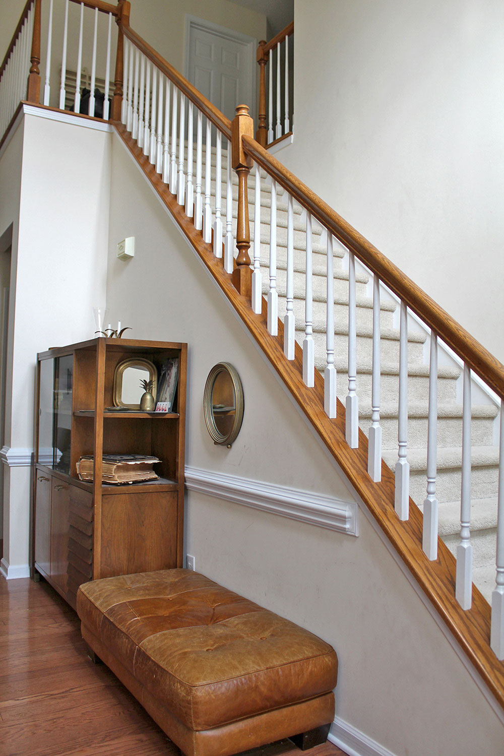 staircase & home entryway with high ceilings (before makeover)