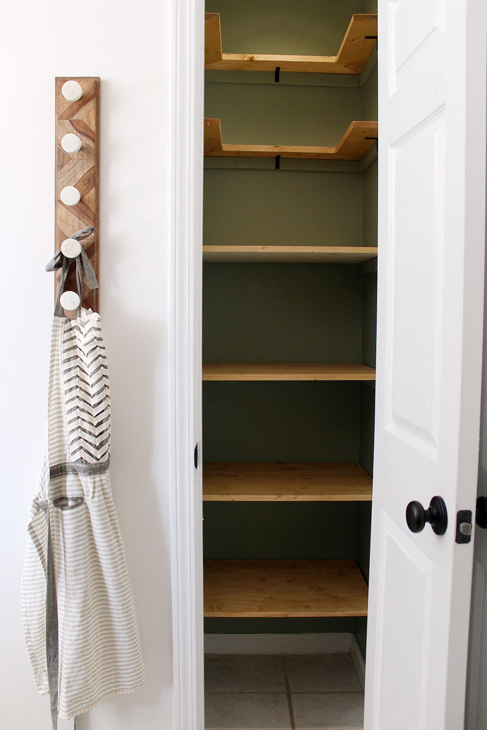 empty_shelves_planning.jpgstart with a blank slate | how to store more in a kitchen pantry