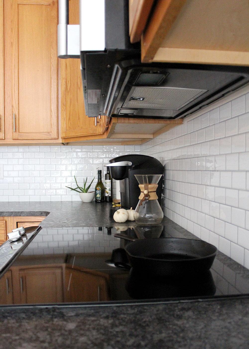 DIY peel and stick subway tile backsplash for under $125 #smallbudget #kitchenDIY #weekendproject